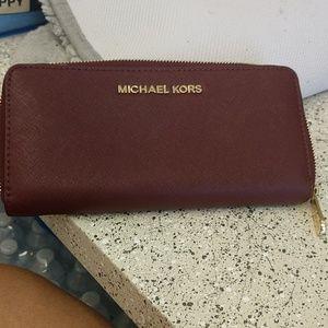 Michael Kors zip around wallet.